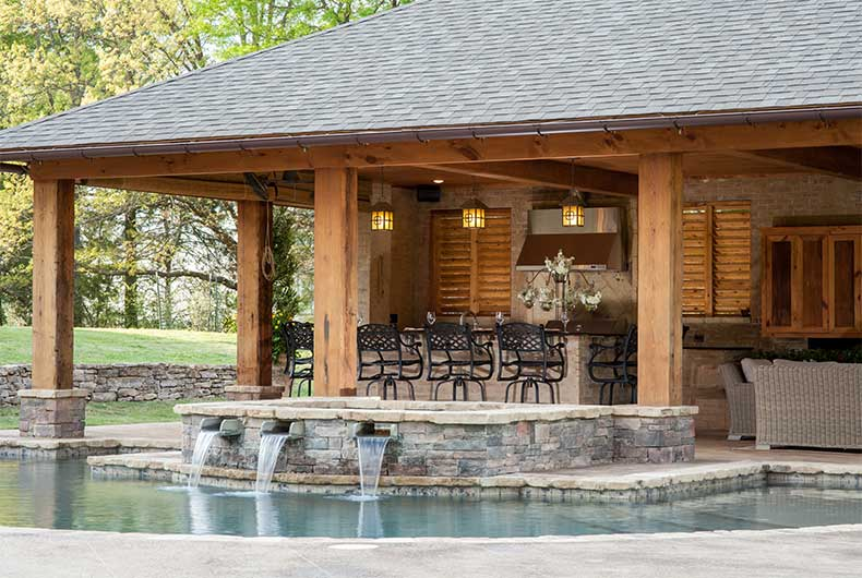 Swimming pools outdoor living spaces outdoor solutions for Pool house designs with outdoor kitchen