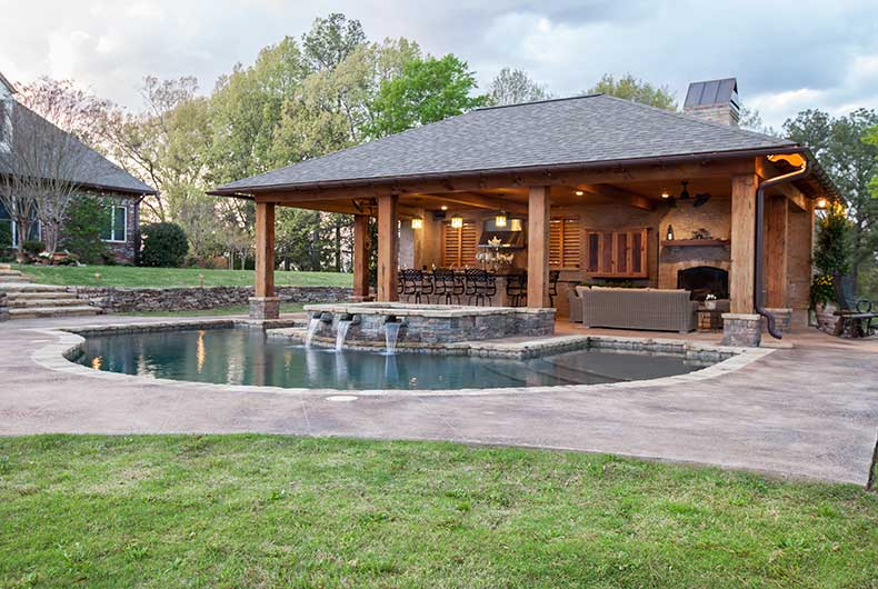 Outdoor living spaces outdoor solutions jackson ms for Pool house designs with outdoor kitchen